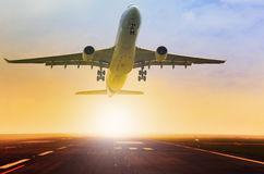 passenger-jet-plane-take-off-fron-airport-runway-beautiful-light-sun-rising-behind-49530716